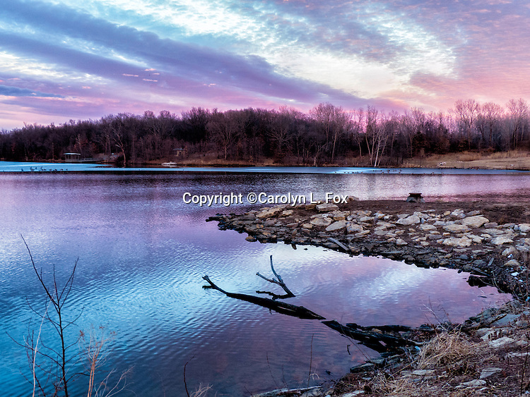 The sky turns into an amazing array of colors as the sun sets at Lake Remembrance in Blue Springs, Missouri, a suburb of Kansas City.