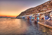 """Sunset at the fishermen houses with the impressive boat shelters, also known as """"syrmata"""" in Klima of Milos, Greece"""