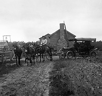 Southwestern Ohio: Man with 4-horse team towing broken down car back to the farm - 1906