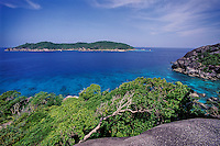 Similan Island Number 9, Ko Bangu, seen from Number 8, Ko Similan. Located some 40 miles off Thailand's west coast, the Similans are considered the Jewel of Thailand's Marine National Park system. Similan Islands, Thailand, Andaman Sea.