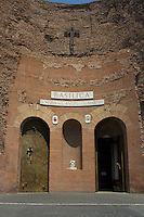 "This is the very modest looking entrance to the ancient basilica, which was once part of the biggest ""terme"" in ancient Rome - Terme di Diocleziano. It was transformed into the S. Maria degli Angeli and dei Martiri church in XVI century according to Michelangelo project. This ancient basilica is standing beside Piazza della Repubblica in Rome, Italy."