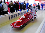 18 December 2010: Simone Bertazzo pushes his 2-man bobsled for Italy, taking the gold at the Viessmann FIBT World Cup Bobsled Championships on Mount Van Hoevenberg in Lake Placid, New York, USA. Mandatory Credit: Ed Wolfstein Photo