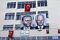 Turkey 1987 .Portraits of Ataturk and general Evren on a building of the municipality of Diyarbakir.Turquie 1987.Portraits de Ataturk et du general Evren sur un batiment administratif de Diyarbakir