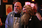 Micki Martin, of the Bearded Lady club poses for a picture with a member of the Queen City Beard and Mustache Society at Cosmic Charlie's nightclub in Lexington, Ky. Jan. 31, 2012. Photo by Brandon Goodwin | Staff