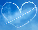 Pierced heart in the sky made of smoke by airplanes at Canadian International Air Show in Toronto