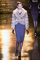 Simona Andrejic walks runway in a blush shearling jacket, and stone stretch crepe dress, from the Badgley Mischka Fall 2011 fashion show, during Mercedes-Benz Fashion Week Fall 2011.