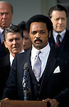 January 4, 1984 Rev. Jesse Jackson speaks at the White House ceremony marking the return of downed U.S. Navy pilot Lt. Robert Goodman from Syria. Behind them are Secretary of State George Schultz and Defense Secretary Caspar Weinberger.