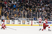 Danny O'Regan (BU - 10), Robbie Baillargeon (BU - 19) and Ahti Oksanen (BU - 2) react as Gaudreau goes in for the empty netter. - The Boston College Eagles defeated the Boston University Terriers 3-1 (EN) in their opening round game of the 2014 Beanpot on Monday, February 3, 2014, at TD Garden in Boston, Massachusetts.