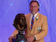 Canton, OH - August 6, 2016: Former NFL player Kevin Greene poses with his bust after giving his speech at the Pro Football Hall of Fame Enshrinement Ceremony in Canton, Ohio, August 6, 2016. Greene played 15 seasons in the NFL and won the league's sack title twice, in 1994 and 1996. He was a member of the NFL's All-Decade Team of 1990s, played in six conference championship games and one Super Bowl. (Photo by Don Baxter/Media Images International)