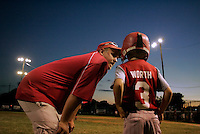 Owens Corning Fiberglass manager Jeremy Brehm gives Austin Worth a pep talk before doing to bat against SJ Professional Printing during the farm division championship game of the Shrine Farm Tournament at Mound City Park in Newark on July 11, 2007.