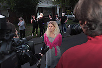 Kelly Page of Dogs Deserve Better speaks to the press after giving a dog locked in a basement water in Shoreline, WA on September 28, 2010.  <br /> <br /> King County Animal Control who has been called to this house on animal cruelty complaints for over seven years, has again been out there a couple of times in the past week but has failed to do anything to help this dog.<br /> It is case # 10-06739. The house is located at :<br /> 14711 23rd Ave. NE., Shoreline, WA 98155.  The house and property are filthy and appears like it should be condemned. (photo &copy; Karen Ducey 2010)