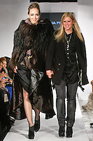 Swiss fashion designer Julia Fory, walks runway with models at the close of her Julia Forey Fall/Winter 2012-2013 Collection fashion show, during BK Fashion Weekend Fall Winter 2012.