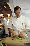 Michel le Bras at his high quality hotel restaurant in Laguiole south west France. He is a Michelin Chef well known for his quality food which is all organically produced and gathered  selectively from the region. The accent on his hotel, the natural materials and conception, reflects the style of his food. he is concerned with the environment, ecology, good produce and excellent standards...Route de l'Aubrac, Aubrac - 12210 Laguiole, France..Perched on a hill-top high in the mountains of the southern Auvernge region of France, miles from anywhere, the unique restaurant and hotel of Chef Michel Bras is regularly full to overflowing. One would swear that this extraordinary chef had studied in Japan from his style of presentation on the plate and his spare artistry in designing his dishes. However, it is only in the last few years that he visited that country for the first time. Those who believe in re-incarnation claim he must have lived previous lives in Japan. Instead, he claims his influence is entirely from his mother's cooking, his abiding love of the wild flora that braves this harsh environment and his passion for the region and town of his birth, Aubrac and Laguiole respectively..