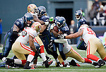 Seattle Seahawks running back Leon Washington, is tackled by San Francisco 49ers Ray McDonald and Issac Sopoaga (90) at  CenturyLink Field in Seattle, Washington on December 24, 2011. Blocking for Washington is Seahawks offensive linemen Robert Gallery (72), and Paul McQuistan (67). The 49ers came from behind to beat the Seahawks 19-17. ©2011 Jim Bryant Photo. All Rights Reserved.