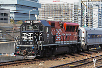 An Metro-North BL20GH diesel locomotive in New Haven livery pulls a short train into Stamford Station in Stamford, Connecticut.
