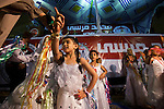 Egyptian girls perform at a rally in support of Egyptian Islamist presidential candidate Dr. Mohamed Morsy May 17, 2012 in the Nile delta city of Benha, Egypt. Morsy, the Muslim Brotherhood's candidate once lagged far behind in the polls, but is now considered a strong underdog candidate because of the legendary organizational machine his group commands during election times. (Photo by Scott Nelson)