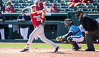 Rhode Island vs Arkansas Razorbacks Men's Baseball – Grant Koch of Arkansas hits one to deep left field against Rhode Island at Baum Stadium, Fayetteville, AR, Sunday, March 12, 2017.  © 2017 David Beach