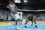 16 February 2013: North Carolina's James Michael McAdoo (43) falls out of bounds after receiving a cut in his lip from a collision with Virginia's Justin Anderson (right). The University of North Carolina Tar Heels played the University of Virginia Cavaliers at the Dean E. Smith Center in Chapel Hill, North Carolina in a 2012-2013 NCAA Division I and Atlantic Coast Conference men's college basketball game. UNC won the game 93-81.