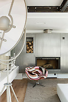 In the living room the stainless steel fireplace was designed by the architect Pablo Katz and commands an entire wall