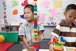 September 14, 2011. Raleigh, NC. . (left to right) Alfredo Benitez and Gian David De La Rosa work with legos. . Project Enlightenment, a public pre-kindergarten program for at risk children, has been threatened with closure due to state wide budget cuts..