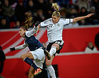 Offenbach, Germany, Friday, April 05 2013: Womans, Germany vs. USA, in the Stadium in Offenbach,   Alex Morgan (USA), Luisa Wensing (GER).