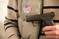 Alexandria, VA,November 8, 2016, USA:  Guns are a hot topic in the 2015 Presidential election.  This gun owner shows off one of his guns after voting in Virginia.  Patsy Lynch/MediaPunch