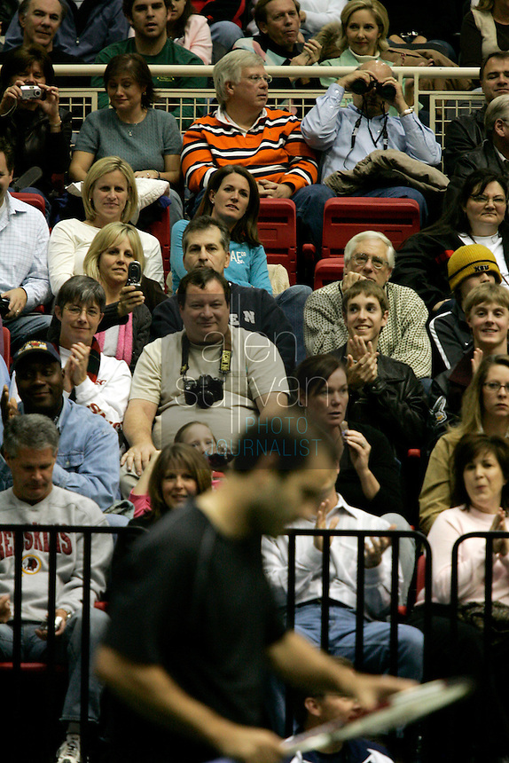 Fans applaud Pete Sampras during his match against local star Robby Ginepri in the FedEx Shootout Atlanta at Kennesaw State University on Saturday, Dec. 9, 2006.