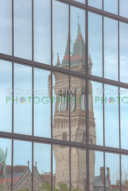Boston's New Old South Church, located in Copley Square, reflected in the windows of the John Hancock building