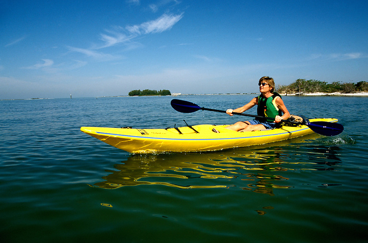 Florida: kayaking near Clearwater, model released.  Photo: flcitr101.Photo copyright Lee Foster, 510/549-2202, lee@fostertravel.com, www.fostertravel.com