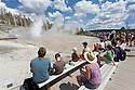 WY00579-00...WYOMING - Croud waiting at Turban and Giant Geysers in the Upper Geyser Basin of Yellowstone National Park.