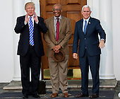 United States President-elect Donald Trump (L) and Vice President-elect Mike Pence (R) pose with Bob Woodson (C) at the clubhouse of Trump International Golf Club, November 19, 2016 in Bedminster Township, New Jersey. <br /> Credit: Aude Guerrucci / Pool via CNP