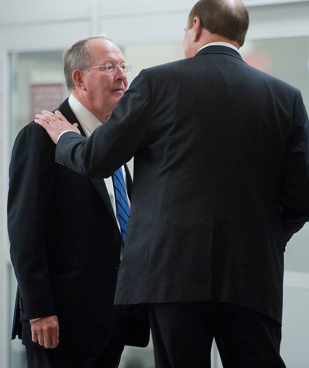 UNITED STATES - OCTOBER 6: Sen. Lamar Alexander, R-Tenn., speaks with Sen. Richard Shelby, R-Ala., in the Senate subway after the cloture vote on the China currency bill in the Senate on Thursday, Oct. 6, 2011. (Photo By Bill Clark/CQ Roll Call)