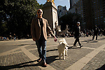 Man and white dog yawning portrait, Columbus Circle, Central Park, NYC