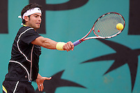 Simone Bolelli (ITA) against Jeremy Chardy (FRA) in the second round of the Men's Singles. Chardy beat Bolleli 6-2 6-3 4-6 4-6 6-1..Tennis - French Open - Day 5 - Wed 28th May 2009 - Roland Garros - Paris - France..Frey Images, Barry House, 20-22 Worple Road, London, SW19 4DH.Tel - +44 20 8947 0100.Cell - +44 7843 383 012