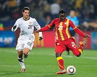 Kwadwo Asamoah of Ghana and Benny Feilhaber of Ghana. Ghana defeated the USA 2-1 in overtime in the 2010 FIFA World Cup at Royal Bafokeng Stadium in Rustenburg, South Africa on June 26, 2010.