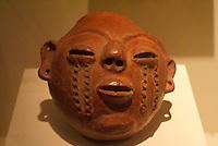Ceramic clay head, Mesoamerican god Xipe Totec, Museo Nacional de Antropologia David J. Guzman in San Salvador, El Salvador