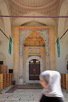 Main entrance to the Gazi Husrev-beg Mosque, built 1530-32, with arched doorway and muqarnas above, Sarajevo, Bosnia and Herzegovina. The complex includes a maktab and madrasa (Islamic primary and secondary schools), a bezistan (vaulted marketplace)and a hammam. The mosque was renovated after damage during the 1992 Siege of Sarajevo during the Yugoslav War. Picture by Manuel Cohen