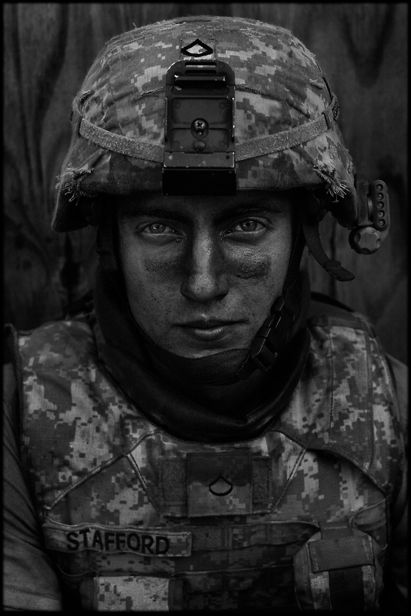 A soldier from  C Co. 2-12 Infantry Regiment 4th Brigade 4th Infantry Division at COP Honiker-Miracle in Afghanistan's Pesh River Valley in the summer of 2009.