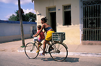 Mother with boy on bicycle, Trinidad, Cuba, Caribbean