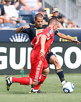 Fred #7 of the Philadelphia Union tackles Chad Barrett #19 of Toronto FC during an MLS match at PPL stadium in Chester, PA. on July 17 2010. Union won 2-1 with a last minute penalty kick goal.