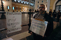 Roma 13 Ottobre 2009.Manifestazione contro la bocciatura della legge sull'omofobia,indetta dalla comunità omosessuale e non,davanti al Palazzo di Montecitorio..Demonstration against the rejection of the Law on homophobia, issued by the homosexual community and not in front of the Palace of Deputies..The banner reads:We make them the names of parliamentarians homosexuals?.of side: Parliament = more numerous than democrats