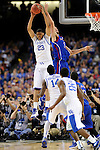 2 APR 2012: Forward Anthony Davis (23) from the University of Kentucky pulls down a rebound in front of center Jeff Withey (5) from The University of Kansas during the Championship Game of the 2012 NCAA Men's Division I Basketball Championship Final Four held at the Mercedes-Benz Superdome hosted by Tulane University in New Orleans, LA. Kentucky defeated Kansas 67-59 to claim the championship title. Ryan McKeee/ NCAA Photos.