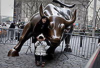 wall street bull sculpture in New York, United States. 11/01/2012. Officials announced the arrival of the record-breaking 50 millionth visitor of the year. Photo by Kena Betancur / VIEWpress.