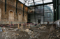 New Caledonia Glasshouse (formerly The Mexican Hothouse) built in the 1830s by Charles Rohault de Fleury, Jardin des Plantes, Museum National d'Histoire Naturelle, Paris, France. General view showing renovation works in progress on the floor. Through the glass wall the Tropical Rainforest Glasshouse (formerly Le Jardin d'Hiver or Winter Gardens), 1936, René Berger, is visible. The New Caledonia Glasshouse, or Hothouse, was the first French glass and iron building.