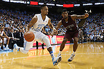14 November 2014: North Carolina's J.P. Tokoto (13) and NC Central's Dante Holmes (0). The University of North Carolina Tar Heels played the North Carolina Central University Eagles in an NCAA Division I Men's basketball game at the Dean E. Smith Center in Chapel Hill, North Carolina. UNC won the game 76-60.