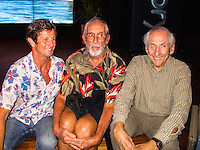 """HONOLULU, Turtle Bay Resort, North Shore, Oahu. - (Thursday, January 3, 2013) Mark Warren (AUS), Kimo Hollinger (HAW) and Peter Cole (USA). Greg Noll (USA) was the guest  speaker of Talk Story at Surfer The Bar tonight, Noll, nicknamed """"Da Bull"""" by Phil Edwards in reference to his physique and way of """"charging"""" down the face of a wave is an American pioneer of big wave surfing and is also acknowledged as a prominent longboard shaper. Noll was a member of a US lifeguard team that introduced Malibu boards to Australia around the time of the Melbourne Olympic Games. Noll became known for his exploits in large Hawaiian surf on the North Shore of Oahu. He first gained a reputation in November 1957 after surfing Waimea Bay in 25-30 ft surf when it had previously been thought impossible even to the local Hawaiians. He is perhaps best known for being the first surfer to ride a wave breaking on the outside reef at the so-called Banzai Pipeline in November 1964...It was later at Makaha, in December 1969, that he rode what many at the time believed to be the largest wave ever surfed. After that wave and the ensuing wipeout during the course of that spectacular ride down the face of a massive dark wall of water, his surfing tapered off and he closed his Hermosa Beach shop in the early 1970s. He and other surfers such as Pat Curren, Mike Stang, Buzzy Trent, George Downing, Mickey Munoz, Wally Froyseth, Fred Van Dyke and Peter Cole are viewed as the most daring surfers of their generation...Noll is readily identified in film footage while surfing by his now iconic black and white horizontally striped """"jailhouse"""" boardshorts and was interviewed by host Jodi Wilmott (AUS). . Photo: joliphotos.com"""