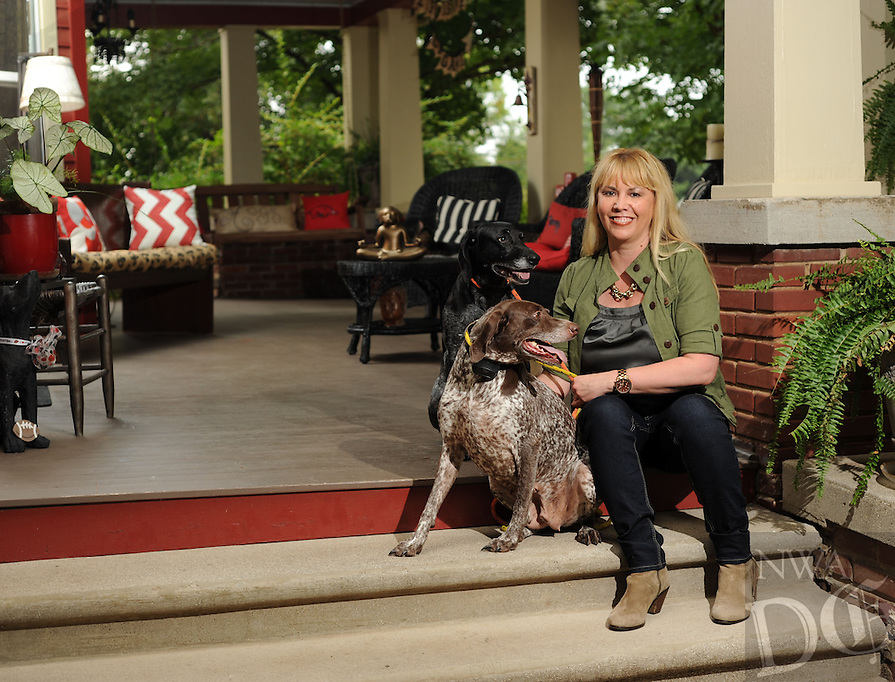 NWA Democrat-Gazette/ANDY SHUPE<br /> Amy White's favorite place is the front porch at her historic Fayetteville home which she shares with her dogs Harper (back) and Natalie. Tuesday, Aug. 18, 2015