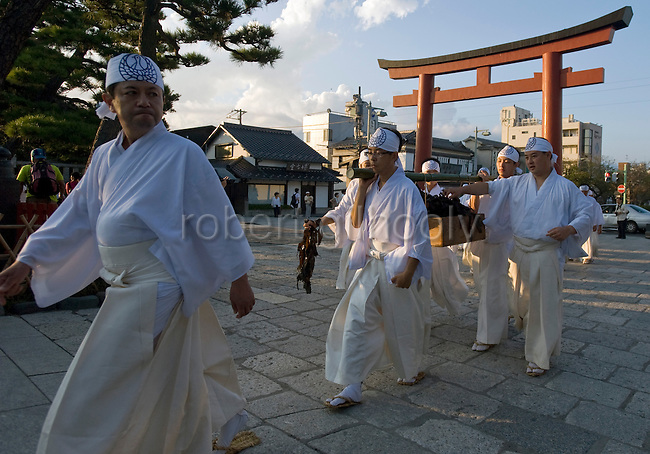 The annual Reitaisai Grand Festival at Tsurugaoka Hachimangu Shrine in Kamakura, Japan on  14 Sept. 2012.  Sept 14 marks the first day of the 3-day Reitaisai festival, which starts early in the morning when shrine priests and officials perform a purification ritual in the ocean during a rite known as hamaorisai and limaxes with a display of yabusame horseback archery. Photographer: Robert GilhoolyPriests and parishioners carry a crate if seaweed following the hamaorisai rite during the the annual Reitaisai Grand Festival at Tsurugaoka Hachimangu Shrine in Kamakura, Japan on  14 Sept. 2012.  Sept 14 marks the first day of the 3-day Reitaisai festival, which starts early in the morning when shrine priests and officials perform a purification ritual in the ocean during a rite known as hamaorisai and limaxes with a display of yabusame horseback archery. Photographer: Robert Gilhooly