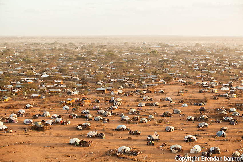 In 2011 refugees fled Somalia in such numbers that the existing camps in dadaab kenya couldn't hold them. They settled on the oustkirts of Dagahaley and Ifo in self built structures. These are at the edge of Dagahaley and  the refugees here are being moved to Ifo extention a tented camp that opened in august 2011 that is closer to services, schools and health centers. October 2011. Brendan Bannon/IOM/UNHCR
