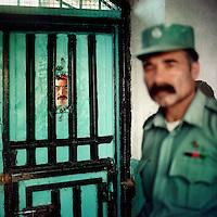 Prisoner and guard in Herat jail.